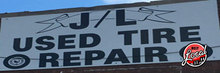 Normal_jl-used-tires-building-sign-coupon